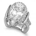 Custom pear shape diamond wedding ring with round diamonds