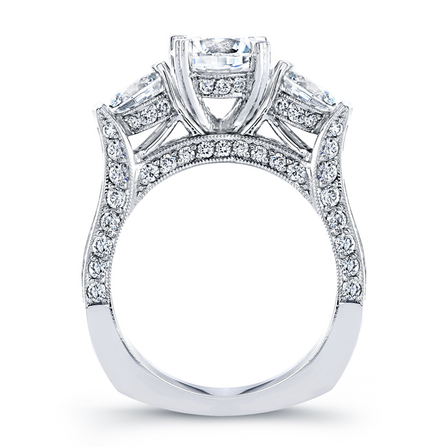 Three stone engagement ring with pavee set diamonds